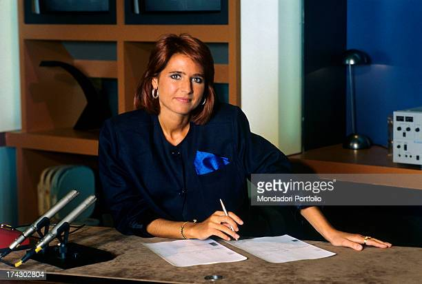 The Italian journalist Lilli Gruber born Dietlinde Gruber poses satisfied for the photographer in a television studio her work place Italy 1987