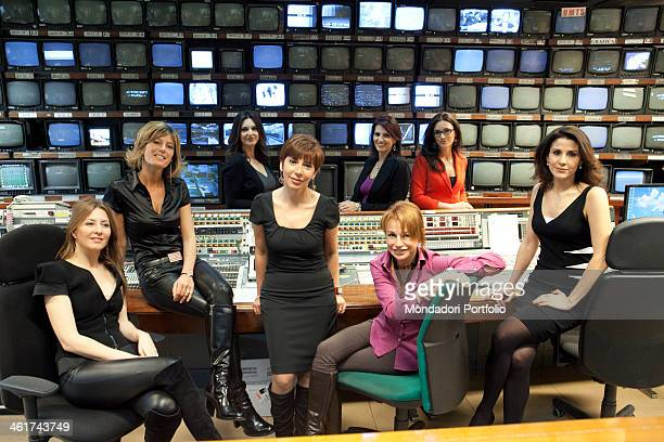 The Italian journalists and presenters of TG1 news posing in the television studio From the left in the first line we can recognize Barbara Carfagna...
