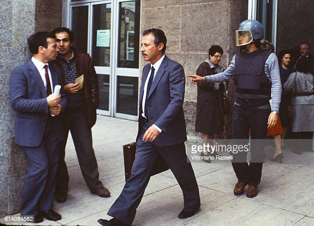 The Italian judge Paolo Borsellino escorted by police out of the court in Palermo Italy in May 22 1985 Paolo Borsellino he was killed'n  by the Mafia...