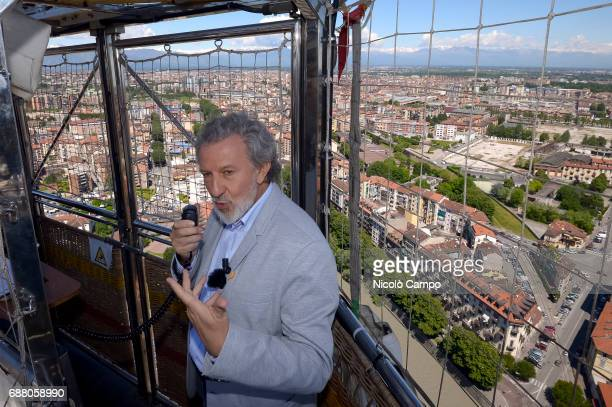 The Italian mathematician and logician Piergiorgio Odifreddi speaks on a hot air balloon during an event of the 30th Turin International Book Fair