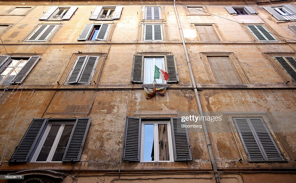 The Italian national flag flies from the window of a residential property in downtown Rome, Italy, on Friday, Jan. 25, 2013. Italian Prime Minister Mario Monti said the Bank of Italy will take another look at Banca Monte dei Paschi di Siena SpA's books after the company disclosed this week it may face more than 700 million euros of losses related to structured finance transactions hidden from regulators. Photographer: Alessia Pierdomenico/Bloomberg via Getty Images