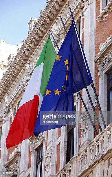 The Italian national flag left and the European Union flag fly from the rear of the Palazzo Montecitorio home to the government's Chamber of Deputies...