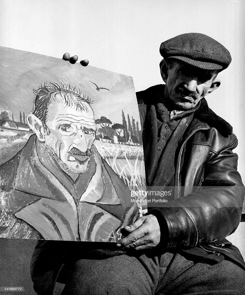 The Italian painter Antonio Ligabue posing with a self-portrait. Reggio Emilia, March 1961