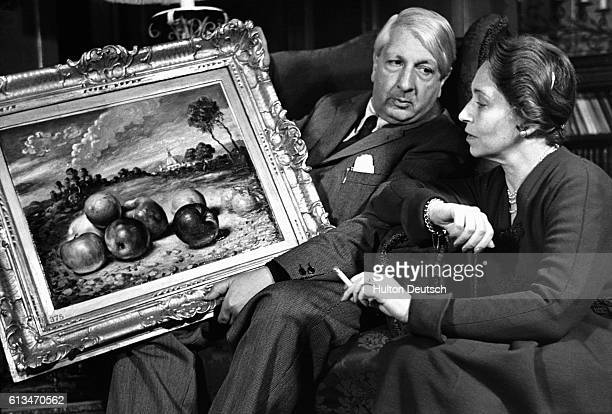 The Italian painter Giorgio de Chirico seeks his wife's opinion on one of his paintings