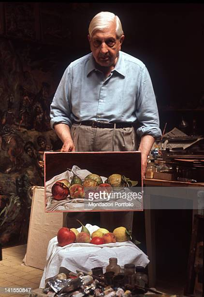 The Italian painter Giorgio de Chirico showing a stilllife picture painted by him Roma July 1967