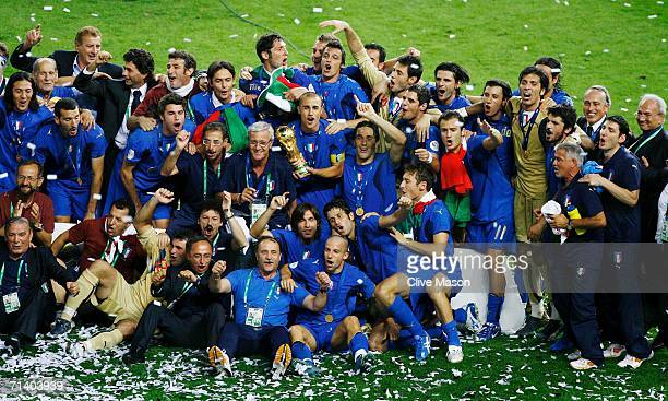The Italian players and coaching staff celebrate following their victory in a penalty shootout at the end of the FIFA World Cup Germany 2006 Final...