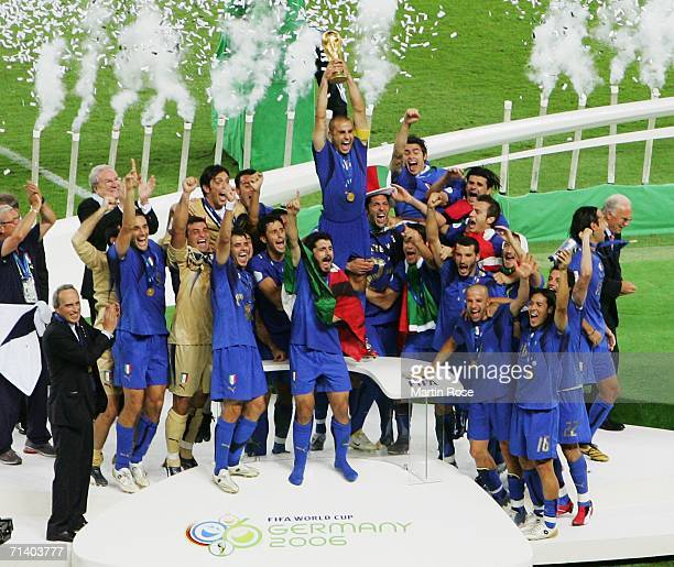 The Italian players celebrate as Fabio Cannavaro of Italy lifts the World Cup trophy aloft following his team's victory in a penalty shootout at the...