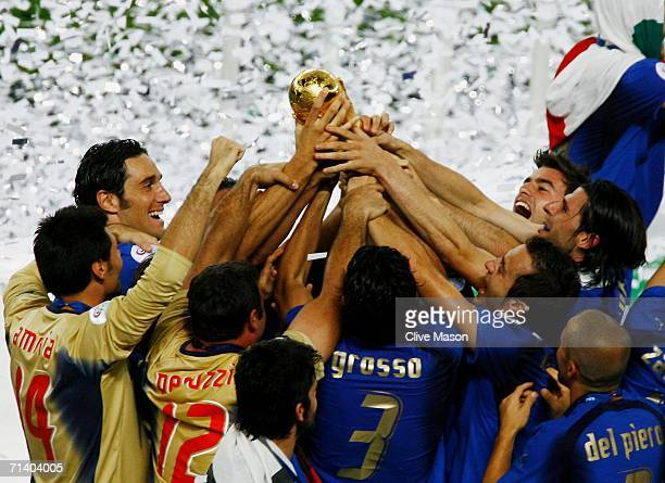 The Italian players celebrate with the World Cup trophy following their victory in a penalty shootout at the end of the FIFA World Cup Germany 2006...
