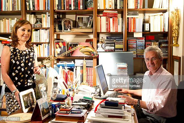 The Italian politician Francesco Rutelli smiles at his desk with his wife Barbara Paolombelli in their house in Rome Italy Rome 27th April 2011