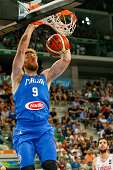 The italian power forward Nicolò Melli shoots a basket in the match between Italy and Tunisia at 2016 FIBA Olympic Qualifying Tournament in Turin...