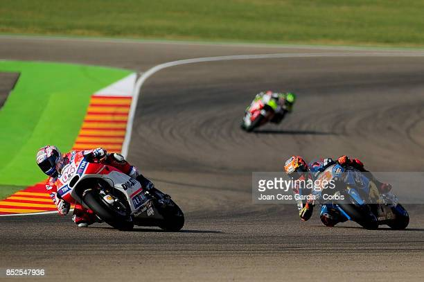 The Italian rider Andrea Dovizioso of Ducati Team and Spanish rider Tito Rabat of EG 00 Marc VDS in action during the Gran Premio Movistar de Aragón...