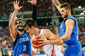 The italian shooting guard Marco Stefano Belinelli and The italian power forward Danilo Gallinari defend against a drive to the basket by The...