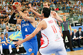 The italian shooting guard Pietro Aradori defends against a drive to the basket by The tunisian power forward Mohamed Mokthar Ghyaza in the match...
