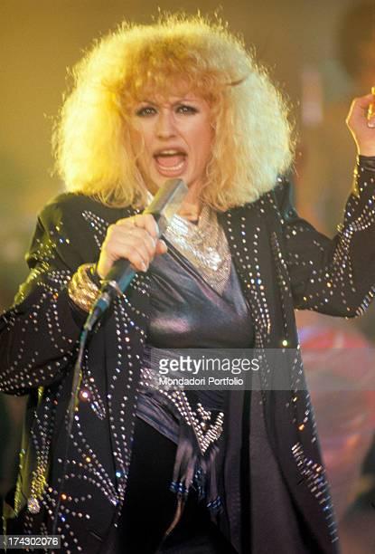 The Italian showgirl Raffaella Carrà artistic name Raffaella Maria Roberta Pelloni with her unique curly hairdo during a performance 1980
