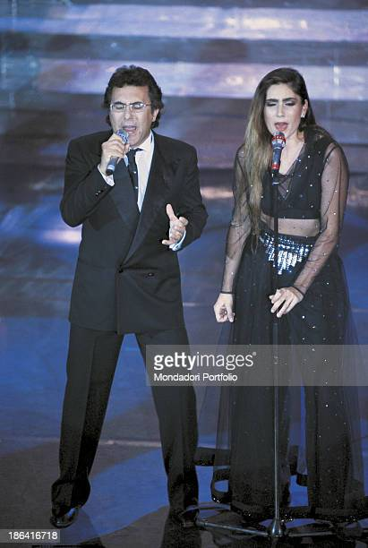 The italian singer Al Bano born Albano Carrisi and his wife Romina Power american singer sing 'Oggi sposi' during the Sanremo Music Festival Sanremo...