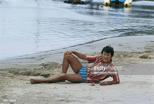 The italian singer Al Bano born Albano Carrisi relaxes on the beach of Punta Ala Punta Ala Italy 1968