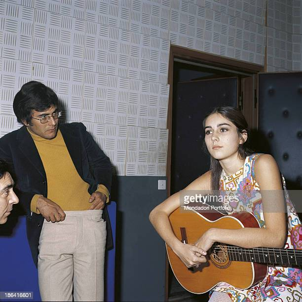 The italian singer Al Bano born Albano Carrisi with his girlfriend the american singer Romina Power in a recording studio Romina Power holds in her...