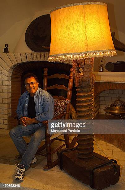 'The italian singer Albano Carrisi in art Al Bano relaxes sitting on a chair in his house on the Puglia's estate Cellino San Marco 2002 '