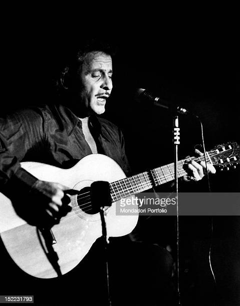 The Italian singer and actor Domenico Modugno singing a song accompanying himself on the acoustic guitar Garlasco 1970s