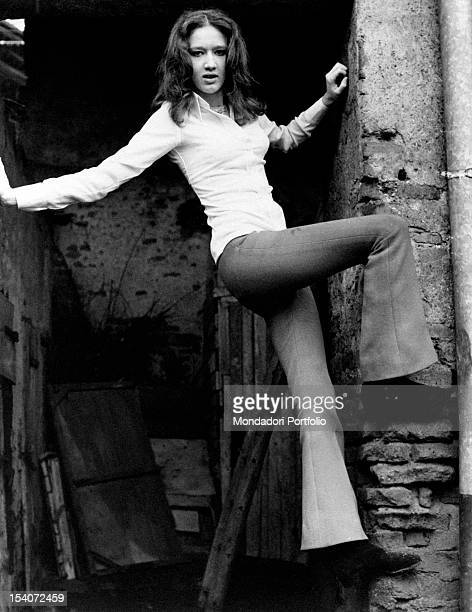 The Italian singer Fiorella Mannoia posing leaning on a wall April 1969