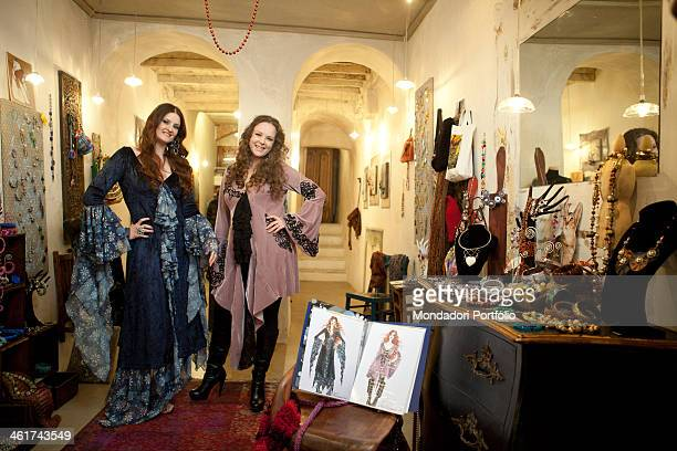 The Italian singer Irene Fornaciari poses wearing a dress designed by her sister Alice Fornaciari clothing and accessories designer They are in...