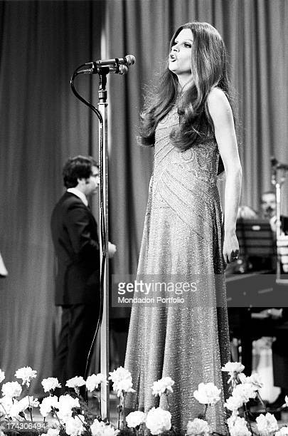 The italian singer Iva Zanicchi in evening dress performs on stage at the Sanremo Music Festival She will win this year's edition together with Bobby...