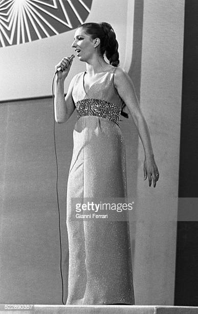 The italian singer Iva Zanicchi in evening dress performs on stage of the Eurovision Song Contest 29th March 1969 Madrid Spain