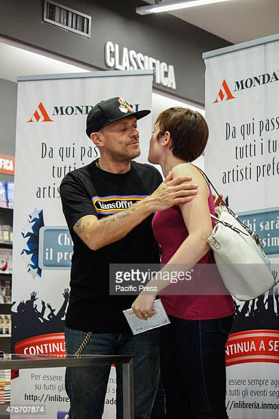 The Italian singer Max Pezzali former leader of the group 883 greets his fan during his signing of copies of his latest album 'Spaceship Max' to...