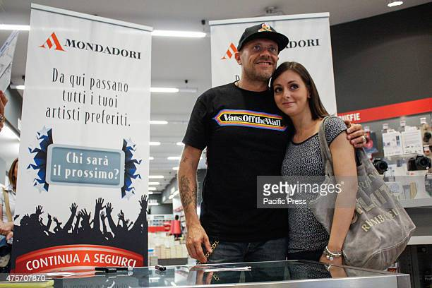 The Italian singer Max Pezzali former leader of the group 883 poses with his fan during his signing of copies of his latest album 'Spaceship Max' to...