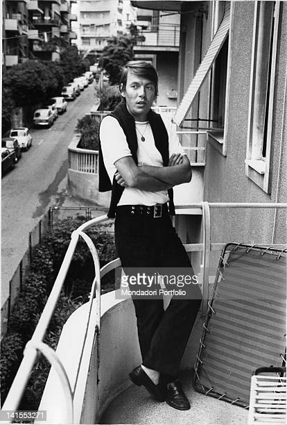 The Italian singersongwriter Fabrizio De Andre leaning on the parapet of a balcony Genoa 1970s