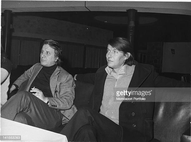 The Italian singersongwriter Fabrizio De Andre sitting next to Sergio Bernardini owner of the 'La Bussola' nightclub Viareggio 1974