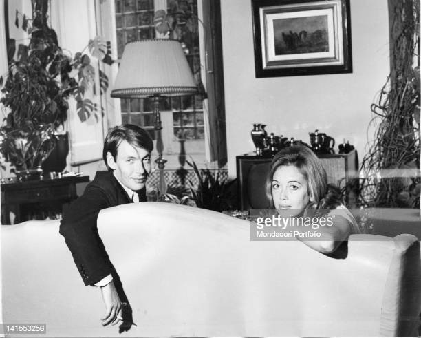 The Italian singersongwriter Fabrizio De Andre sitting on the couch with wife Puny Genoa 1960s