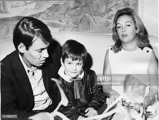 The Italian singersongwriter Fabrizio De Andre sitting on the couch with son Cristiano and first wife Puny Genoa 1960s