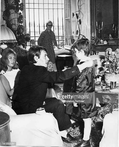The Italian singersongwriter Fabrizio De Andre talking with his son Crisitiano With them the songwriter's wife Puny and his mother Luisa Genoa 1968