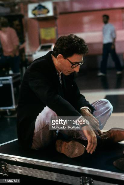 The Italian songwriter and singer Francesco Battiato known as Franco Battiato seated crosslegged on a portmanteau is relaxing and meditating while...