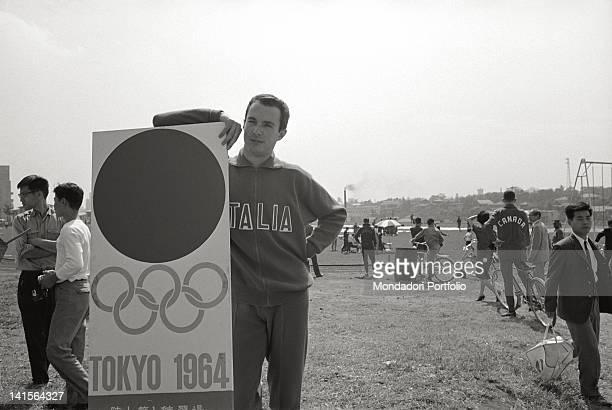 The Italian sprinter Livio Berruti posing against the Tokyo Olympics sign Japan October 1964