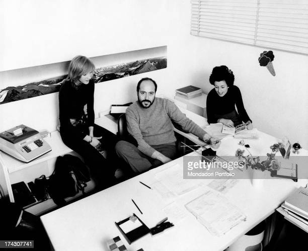 The Italian stylist Elio Fiorucci is in his office with two collaborators Milan 1971