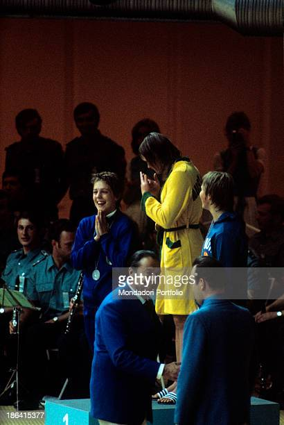 The Italian swimmer Novella Calligaris on the Olympic podium together with the Australian Shane Gould and the Federal German Gudrun Wegner the young...