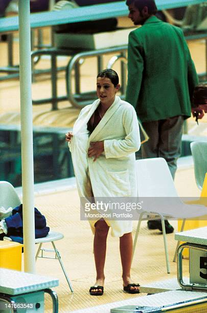 The Italian swimmer Novella Calligaris puts on her bathrobe after a race at the Games of XX Olympiad of Munich where she succeded to win two bronze...