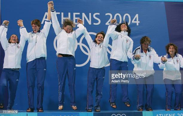 The Italian team jump in celebration before being presented with the gold medal after winning gold in extra time in the women's Water Polo gold medal...