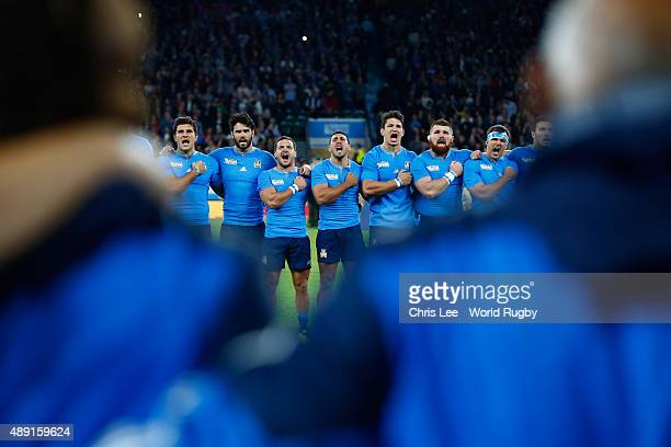 The Italian team sign their national anthem ahead of the 2015 Rugby World Cup Pool D match between France and Italy at Twickenham Stadium on...