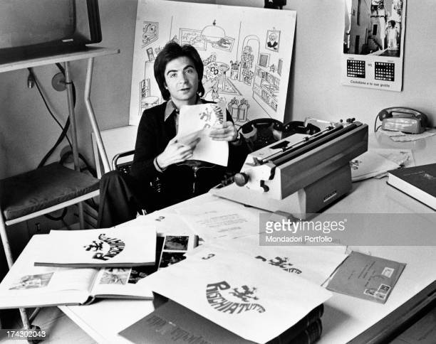 The Italian television anchor and author Paolo Limiti in his studio office of the famous transmission Rischiattutto his desk is covered with drawings...