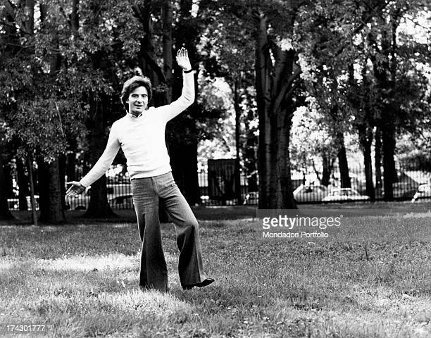 The Italian television anchor and author Paolo Limiti is in a park and ready to do a cartwheel Milan 1973