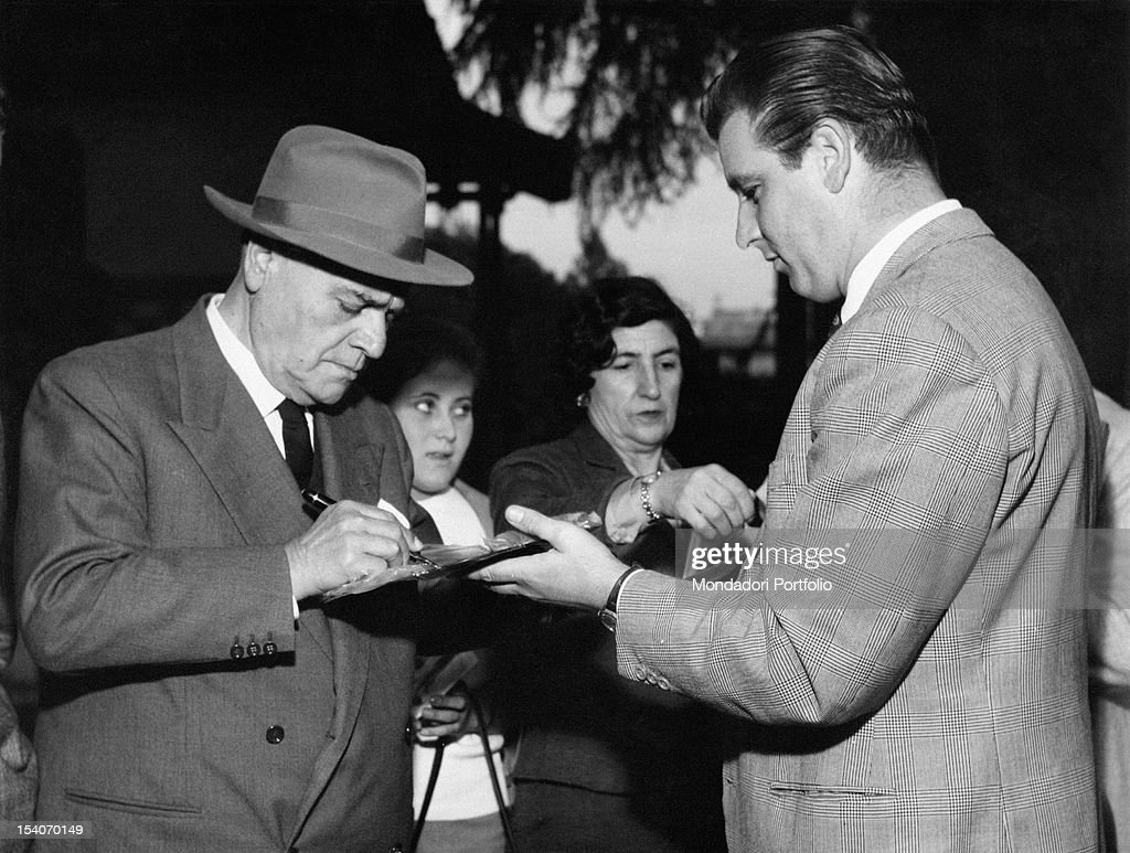 The Italian tenor Beniamino Gigli signing a record of an opera recorded by him for a fan Rome 27th October 1957