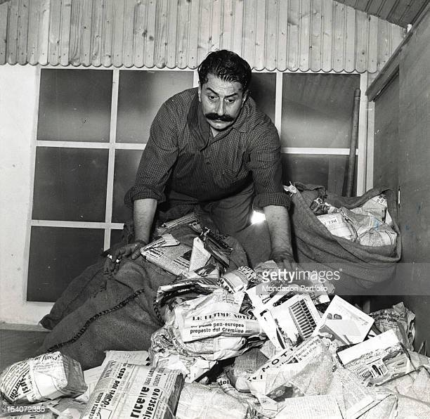 The Italian writer and journalist Giovannino Guareschi in his home while ransacking in bags of mail after his release Roncole di Busseto July 1955