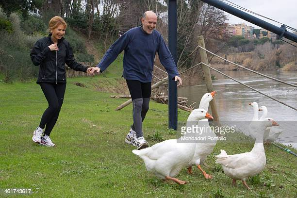 The Italian writer and journalist Lilli Gruber and her husband French journalist and writer Jacques Charmelot run after a group of geese in the...
