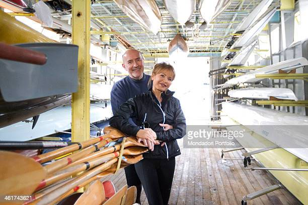 The Italian writer and journalist Lilli Gruber and her husband French journalist and writer Jacques Charmelot pose inside a storage room for canoes...