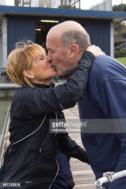 The Italian writer and journalist Lilli Gruber kisses her husband the French journalist and writer Jacques Charmelot at the Aniene Rowing Club Rome...