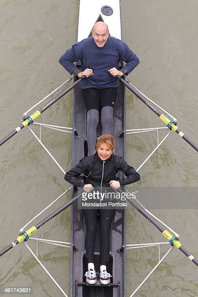 The Italian writer and journalist Lilli Gruber with her husband the French journalist and writer Jacques Charmelot smile while canoeing on the river...
