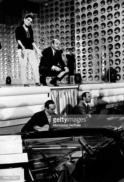 The ItalianAmerican singer Connie Francis is on the stage of Sanremo Music Festival with the organizer Gianni Ravera Sanremo 1967